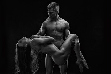 Fototapeta Fitness / Siłownia Nude sexy couple. Art photo of young adult man and woman. High contrast black and white muscular naked body