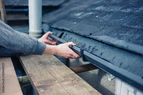 Fotografie, Obraz  Hands of worker fixing drain