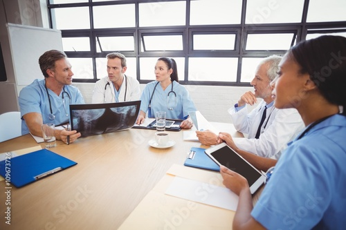 Fototapety, obrazy: Medical team interacting in conference room