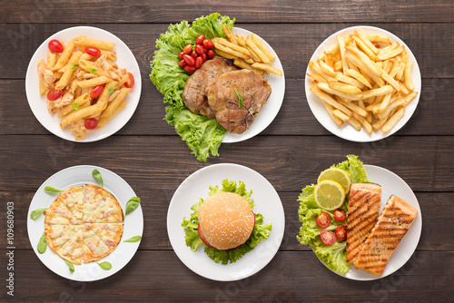 Various food set on the wooden background © Delicious