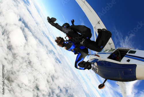 Skydiving tandem jumping from the plane Wallpaper Mural