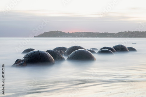 Moeraki Boulders on the Koekohe beach, New Zealand during sunrise (long exposure Canvas Print