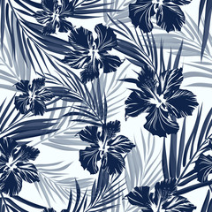 Fototapeta Egzotyczne Tropical seamless monochrome blue indigo camouflage background with leaves and flowers