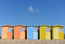 Row Of Colourful Beech Huts And Blue Sky