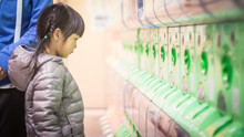 Little Girl Wanting Toys From Japanese Toys Vending Machine