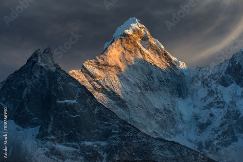 Photo  Majestic snowy mountain peak - Ama Dablam (6,812 m) is a one of the most beautiful and impressive peaks of our planet