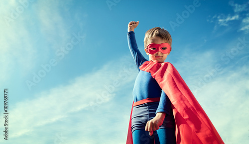 Fotografering  Superhero kid in red cape and mask