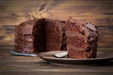 Chocolate Cake On Dark Wooden Bckground