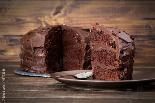 Fototapeta Chocolate cake on dark wooden bckground obraz