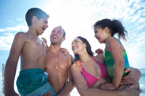 Low angle view of happy family against sky Canvas Print