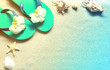 Flip Flops in the sand with shells . Summertime. beach concept.