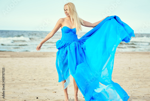 Printed kitchen splashbacks Artist KB Beautiful blonde girl in a blue dress against the sea