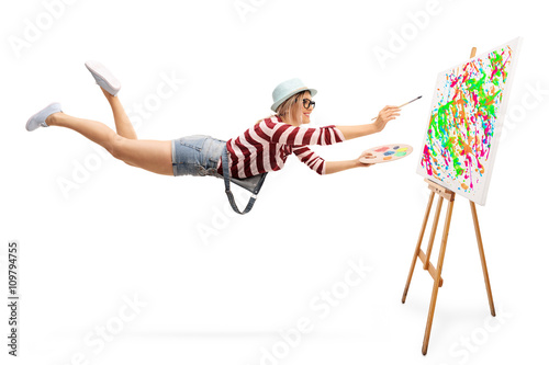 Flying female painter drawing a painting Canvas Print