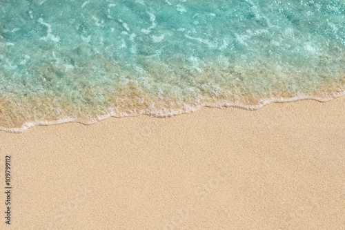 Deurstickers Strand Soft wave of sea on the sandy beach