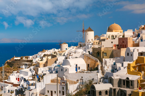 Fototapety, obrazy: Picturesque view of windmills and white houses in Oia or Ia on the island Santorini, Greece