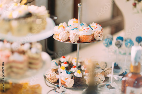 Poster Dairy products Cute cupcakes on tier at wedding reception