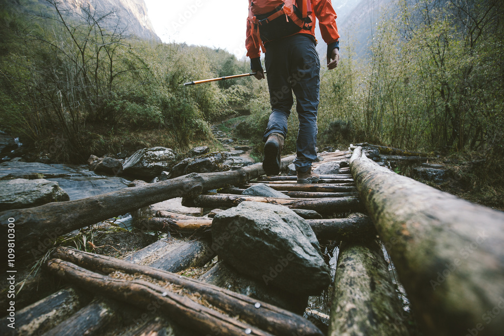 Fototapety, obrazy: Hiker crossing the bridge in Himalayas