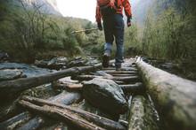 Hiker Crossing The Bridge In H...