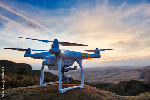 Valokuva  drone quadrocopter with digital camera at sunset
