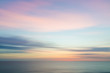 canvas print picture - Blurred defocused sunset sky and ocean nature background.