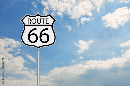 Ingelijste posters Route 66 Route 66 road sign over the cloudy sky