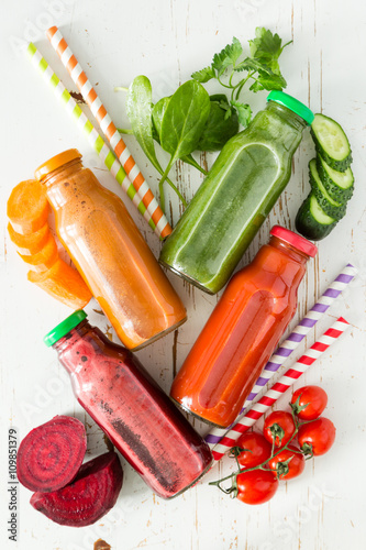 obraz dibond Selection of colorful vegetable juices in glass jars