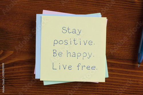 Photo  Stay positive Be happy Live free handwritten on note
