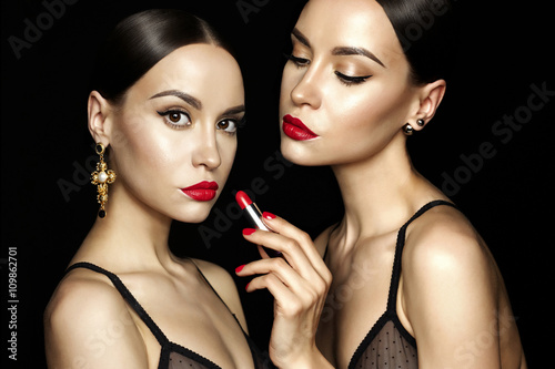 Photo  Two beautiful young ladies with red lipstick