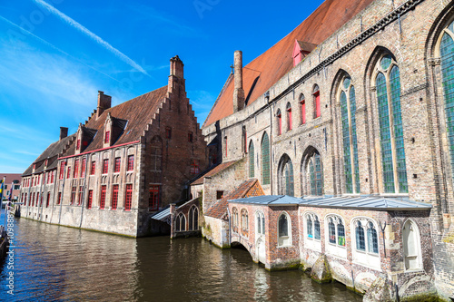 Deurstickers Brugge Scenic cityscape with medieval houses and canal view, Groenerei, in Bruges, Belgium