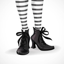 Halloween Closeup Witch Legs In Striped Stockings And Black Boot