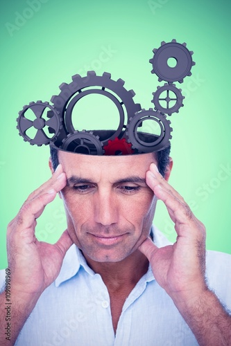 Photo  Composite image of handsome man thinking with hand on forehead