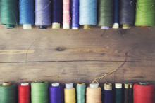 Threads On Wooden Table