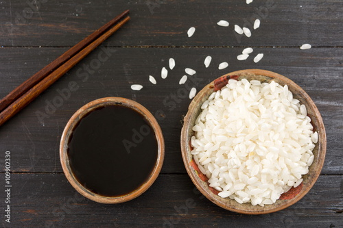 Rice soy sauce and chopsticks