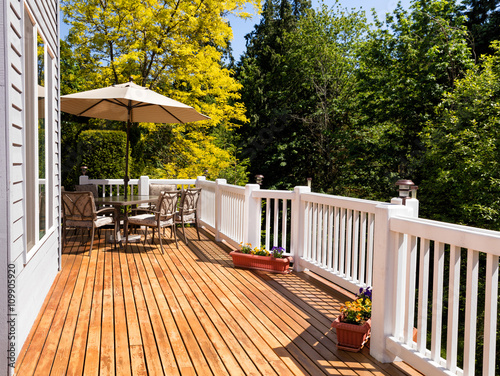 Photo  Home outdoor cedar deck with blooming trees