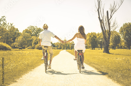 Fotografie, Obraz  Couple of romantic lovers cycling