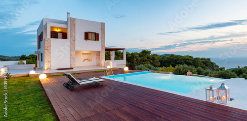 Fotografie, Obraz  Big luxury pool with villa late in the afternoon