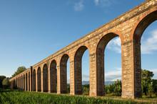 Ancient Italian Aqueduct In Evening Light