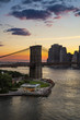 Sunset over the Brooklyn Bridge and Carousel with view on the Manhattan Lower East Side Financial District. East River. New York City