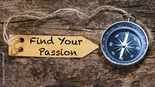 Photo Find your passion - motivation phrase handwriting on label with