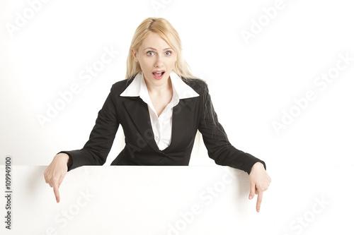Fotografie, Obraz  Beautiful businesswoman with blank signboard