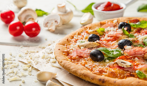 Rustic pizza with ingredients, top view