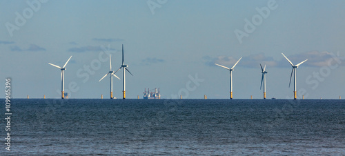 Aluminium Prints Dark grey Wind turbines off shore at Colwyn Bay