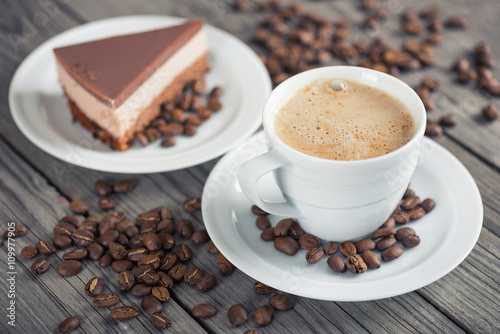 Cup with coffee on the wooden background. Breakfast concept and idea