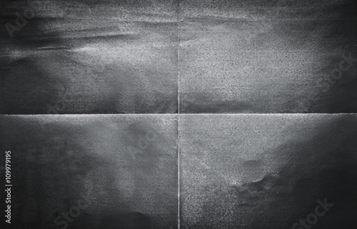 Fotografiet Background pattern of folded black paper in 4 parts