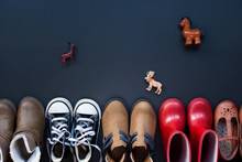 Top View Of Collection Of Kids Clothes On Black Background