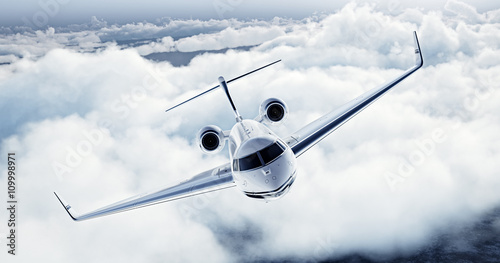 Realistic image of White Luxury generic design private airplane flying over the earth. Empty blue sky with white clouds at background. Business Travel Concept. Horizontal. 3d rendering - 109998971