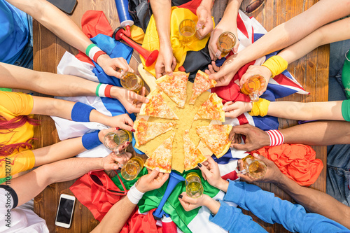 Top view of multiracial hands of football sport supporter sharing pizza - Friend Canvas Print