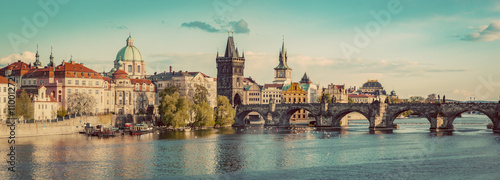 Photo Stands Eastern Europe Prague, Czech Republic panorama with historic Charles Bridge and Vltava river. Vintage