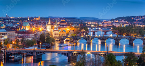 Staande foto Praag Prague, Czech Republic bridges panorama. Charles Bridge and Vltava river at night