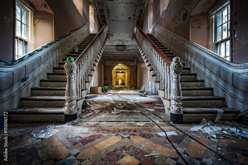 Fotografie, Obraz  Main entrance with symmetrical stairs of an abandoned psychiatric hospital (demo